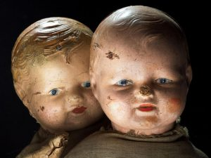 antique dolls as voodoo dolls